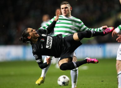 Celtic's Gary Hooper and Juventus's Martin Caceres.