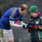 Kerry's Darran O'Sullivan signs an autograph for a Kerry supporter after the game. Pic: INPHO/Cathal Noonan