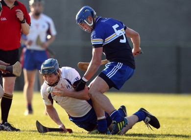 Mary Immaculate's Conor Cooney in action against DIT's Dean Curran.