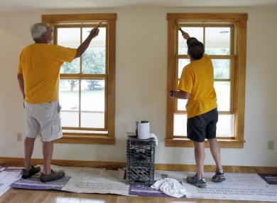 In this July 24, 2012 photo, volunteers Tony Lamb, left, and Ted Marcy work on a Tropical Storm Irene -damaged home