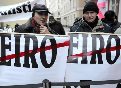 Demonstrators holding posters during a protest at the Latvian parliament in Riga, Latvia, earlier this week.