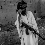 A member of the Taliban shields his face from the photographer in Ghondouz, Afghanistan. (Image: Majid Saeedi)