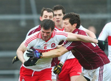 Galway's Micheal Meehan in action against Derry's Mark Lynch.