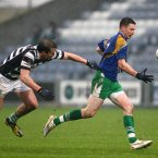 The bad weather in November doesn't deter Longford's Michael Quinn from wearing white Nike boots in a club match.