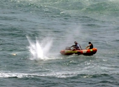 Police in inflatable rubber boats shoot at a shark off Muriwai Beach near Auckland, New Zealand, Wednesday, Feb. 27, 2013