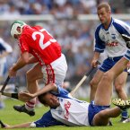 Niall McCarthy breaks the hurley of Ken McGrath in an All-Ireland encounter. (©INPHO/Billy Stickland)