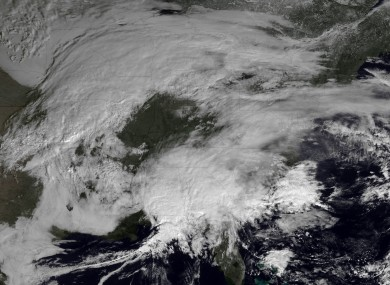 This image made available by NOAA shows storm systems over the eastern half of the United States on Thursday