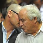 Carl and Henke Pistorius talk during the hearing. ©Pic Chris Ricco/BackpagePix