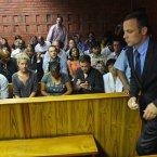 Oscar Pistorius enters the court room during the third day of his bail hearing. ©Pic Chris Ricco/BackpagePix