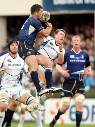 Rob Kearney and Stuart Hogg compete for a high ball.
