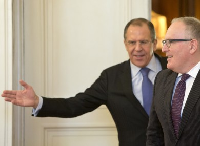 Russian Foreign Minister Sergey Lavrov, left, welcoming his Dutch counterpart Frans Timmermans for a meeting in Moscow, Russia, today.