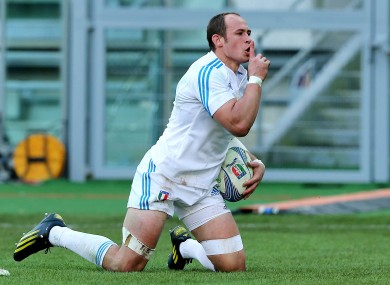 Italy's Sergio Parisse celebrates his try.