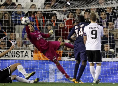 Paris Saint-Germain's goalkeeper Salvatore Sirigu blocks a shot from Valencia during their Champions League round of 16 soccer match.