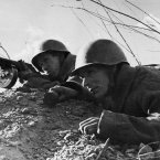 Red Army men in a firing line in the Stalingrad area on Feb. 8, 1943, hold their fire until the enemy is at close range a picture typifying the determination and alertness which has won the soviet forces their smashing victories. (AP Photo)