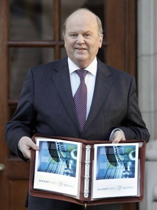 Michael Noonan with his last budget in December 2012.