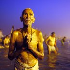 A Hindu devotee prays after a holy dip at Sangam, the confluence of the Ganges, Yamuna and the mythical Saraswati River, during the Maha Kumbh festival in Allahabad, India. (AP Photo /Rajesh Kumar Singh, File)