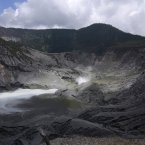 Volcanic smoke spews from crater of Tangkuban perahu volcano in Subang, West Java, Indonesia. Indonesian authorities are closely monitoring the smoking volcano popular with tourists on Java island and are urging everyone to stay off the mountain's slope after it spewed smoke and ash nearly 500 meters (1,640 feet) into the air since Monday. Scientists have put it on the second-highest alert level. (AP Photo/Kusumadireza)