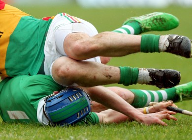 Seamus Hickey of Limerick is tackled against Carlow.