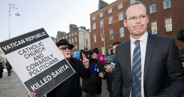 PICS: Cabinet meets protester on way into crucial meeting on abortion