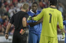 Mario Balotelli freaked out and punched a wall after he was sent off tonight